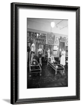 1951: Roberta Peters Working Out with Joseph Pilates and Others in a Studio, New York, NY-Michael Rougier-Framed Photographic Print