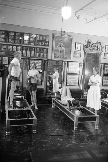 1951: Roberta Peters Working Out with Joseph Pilates and Others in a Studio, New York, NY-Michael Rougier-Photographic Print