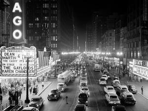 1953 Night Scene of Chicago, State Street with Traffic and Movie Marquee with Pedestrians