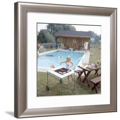 1959: Family Cookout and Enjoying the Backyard Swimming Pool, Trenton, New Jersey-Frank Scherschel-Framed Photographic Print
