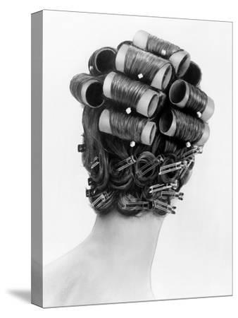1960s Bouffant Hair Styles Created with Big Rollers and Pin Curls to Create a Soft Flip Up at Neck