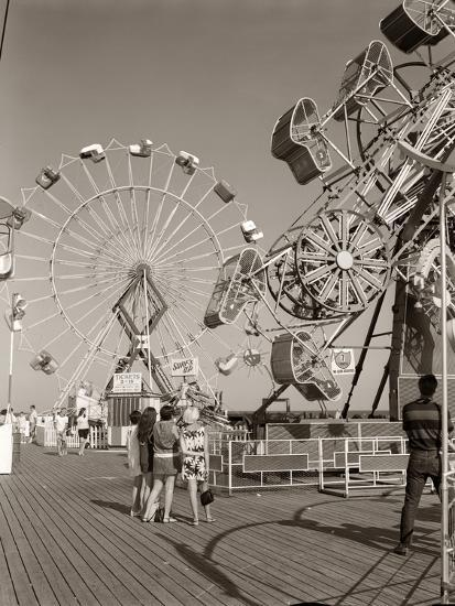 1960s Group of Teens Looking at Amusement Rides on Pier--Photographic Print