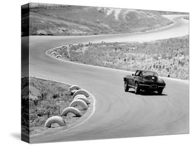 1964 Chevrolet Corvette Stingray on a Winding Racetrack, (C1964)
