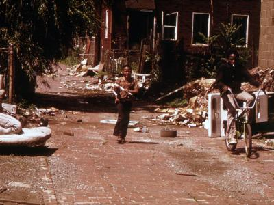1970s America, Two Young Boys Pass Through a Trash-Strewn Alley of Chicago, Early 1973S--Photo