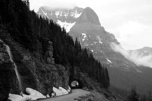 A Black And White Photo Of A Tunnel On The Going-To-The-Sun Road Of A Foggy Valley In Logan Pass by 1photo