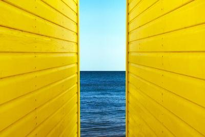 2 Yellow Beach Huts-Andy Bell-Photographic Print