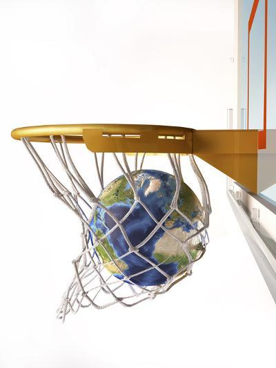 3D Rendering of Planet Earth Falling Into a Basketball Hoop-Stocktrek Images-Photographic Print
