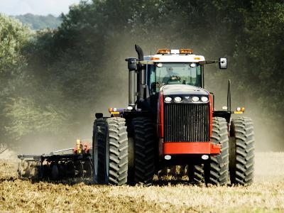 4 Wheel Drive Tractor Pulling a Disc Harrow, Cotswolds, England-Martin Page-Photographic Print