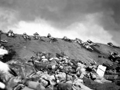 5th Division Marines Crawl Up a Slope on Red Beach No. 1 Toward Mt. Suribachi on Iwo Jima