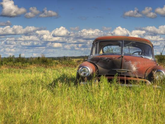 A 1950 Chevrolet Styleline Deluxe 4-Door Sedan Sits Idle in a Field-Pete Ryan-Photographic Print