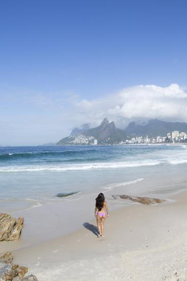 A 20-25 Year Old Young Brazilian Woman on Ipanema Beach with the Morro Dois Irmaos Hills-Alex Robinson-Photographic Print