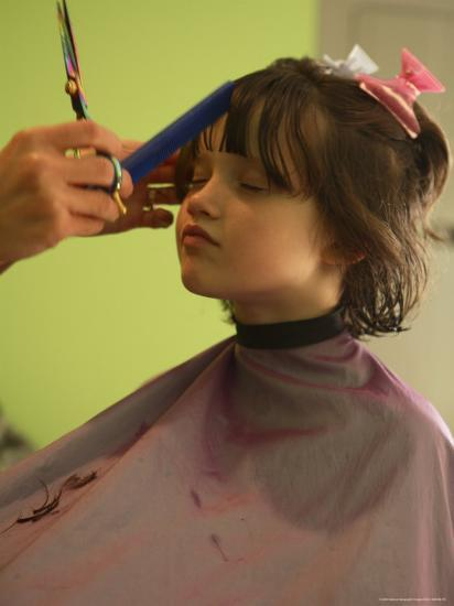 A 6-year-old Girl Gets a Haircut-Stephen Alvarez-Photographic Print