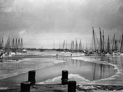 A Frozen Annapolis Harbor and Waterfront by A. Aubrey Bodine