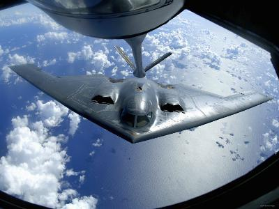 A B-2 Spirit Moves into Position for Refueling from a KC-135 Stratotanker Over the Pacific Ocean-Stocktrek Images-Photographic Print