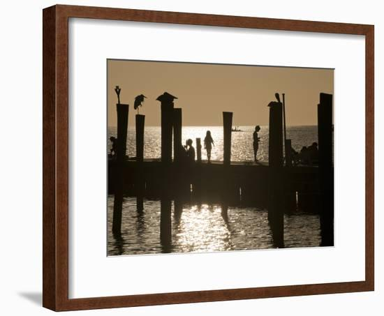 A Backlit View of People on a Pier-Karen Kasmauski-Framed Photographic Print