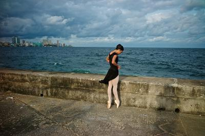 A Ballerina from the National Ballet of Cuba Dances En Pointe on Havana's Malecon-Kike Calvo-Premium Photographic Print