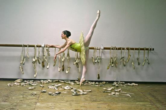 A Ballerina Poses with All the Pointe Shoes She Used in Her Career-Kike Calvo-Photographic Print
