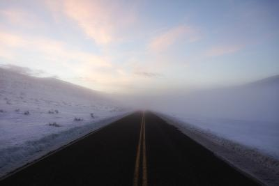 A Bare Roadway Stretches Out into the Misty Frost-Robbie George-Photographic Print
