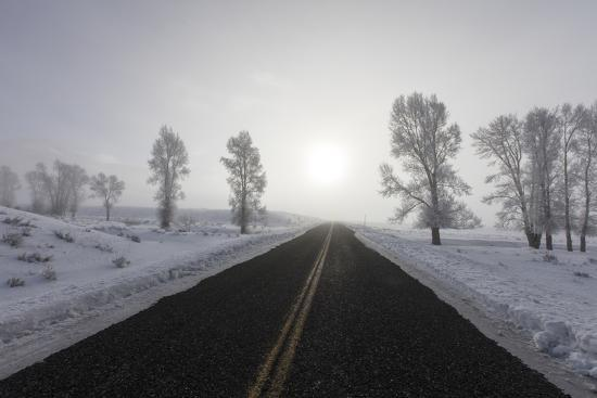 A Bare Winter Road Stretches on for Miles to the Horizon-Robbie George-Photographic Print