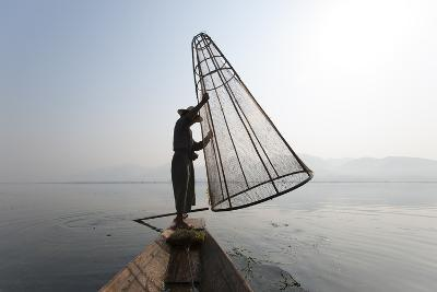 A Basket Fisherman on Inle Lake Prepares to Plunge a Cone Shaped Net-Alex Treadway-Photographic Print