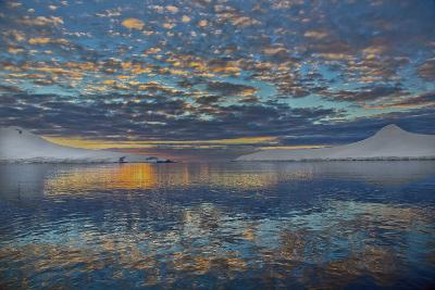 A Beautiful Seascape of Puffy Little Clouds Reflected in Icy Water at Sunset-Ira Meyer-Photographic Print