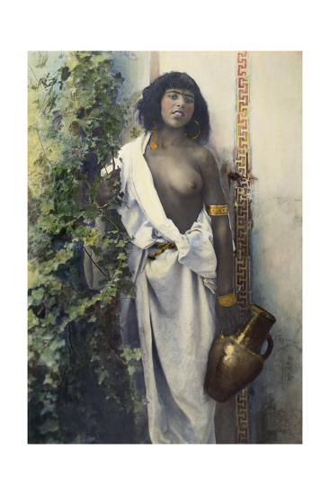 A Bedouin Woman Half Draped in White Cloth Stands Holding an Urn--Photographic Print