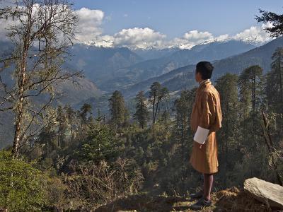 A Bhutanese Man in National Costume Views an Eastern Himalayan Mountain Range from the 11,000-Foot--Nigel Pavitt-Photographic Print