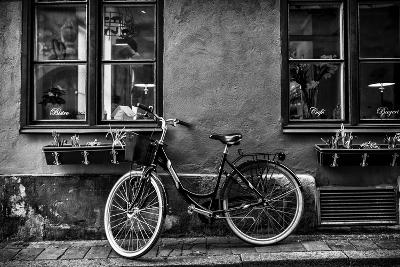 A Bicycle Parked on a Sidewalk Below Two Windows-Jonathan Irish-Photographic Print