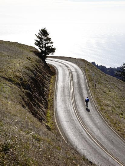 A Bicyclist Riding in Mount Tamalpais State Park, with the Pacific Ocean in the Distance-Keith Barraclough-Photographic Print
