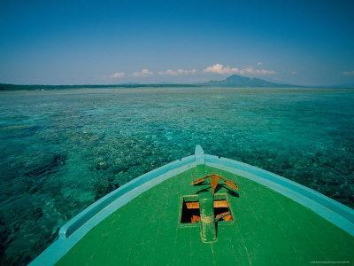 https://imgc.artprintimages.com/img/print/a-boat-anchored-over-a-reef-in-clear-water-with-a-mountain-in-distance_u-l-p4rzk90.jpg?p=0