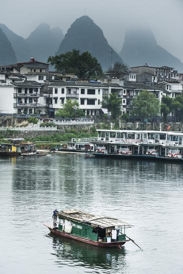 A Boat Crosses the Lijiang River on a Foggy Day in Yangshuo, China-Jonathan Kingston-Photographic Print