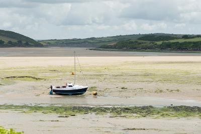 A Boat Moored at Low Tide in the River Camel Estuary at Padstow Cornwall UK-Julian Eales-Photographic Print