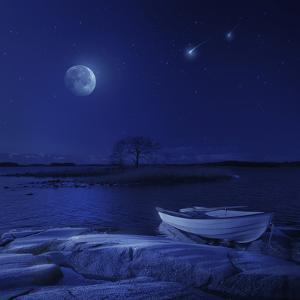 A Boat Moored Near an Icy Stone in a Lake Against Starry Sky, Finland