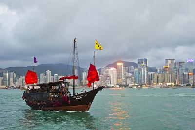 A Boat Named Aqualuna in Victoria Harbor with the Hong Kong Skyline in the Distance-Mike Theiss-Photographic Print
