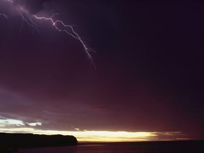 A Bolt of Lightning Crosses a Stormy Sky-Bill Curtsinger-Photographic Print