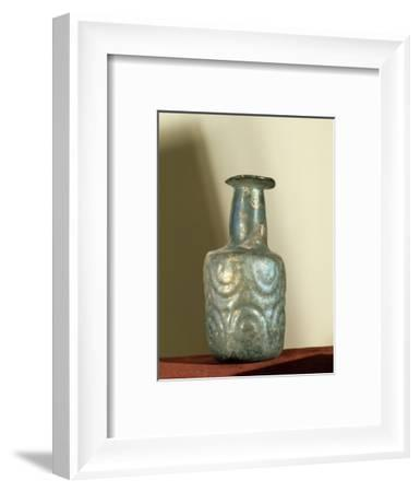 A bottle of irridescent glass-Werner Forman-Framed Giclee Print