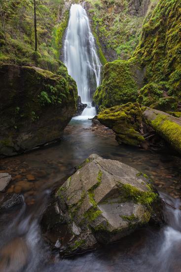 A Boulder At Susan Creek Falls Surrounded By Lush Vegetation-Greg Winston-Photographic Print