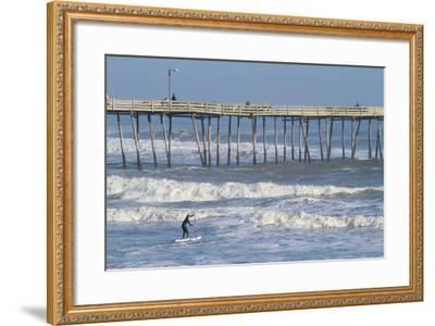 A Boy Paddles Out into Big Waves on His Standup Paddle Board Next to Nags Head Pier-Skip Brown-Framed Photographic Print