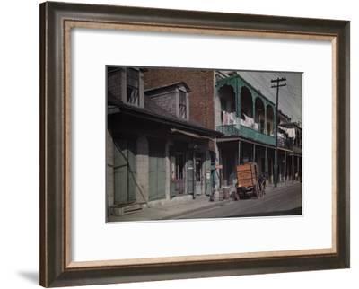 A Boy Sits on a Barrel Outside a Brewery in the French Quarter-Edwin L^ Wisherd-Framed Photographic Print