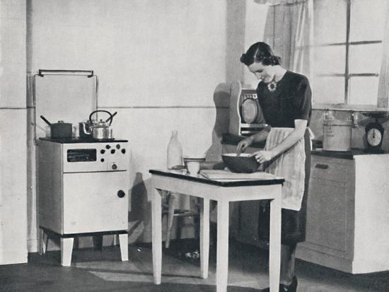 'A British kitchen equipped with a cabinet gas cooker', 1942-Unknown-Photographic Print