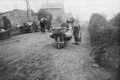 A British Soldier Helping a Woman Return to Her Village, France, 1918--Giclee Print