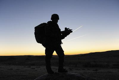 A British Soldier on Patrol as the Sun Rises-Stocktrek Images-Photographic Print