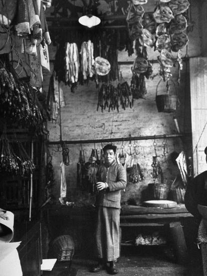 A Butcher Showing His Wares in His Shop--Photographic Print