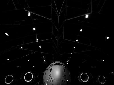 A C-17 Globemaster Iii Sits in a Hangar at Mcchord Field Air Force Base, Washington-Stocktrek Images-Photographic Print