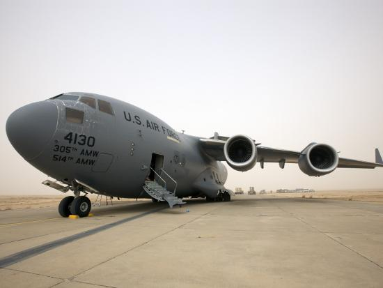 A C-17 Globemaster Iii Sits on the Runway at Cob Speicher, Iraq--Photographic Print
