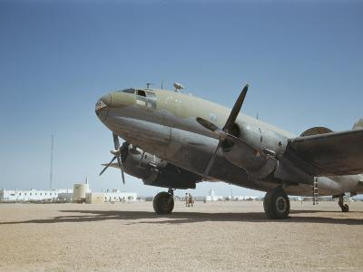 A C-46 at the Airport in Rio De Oro-Maynard Owen Williams-Photographic Print