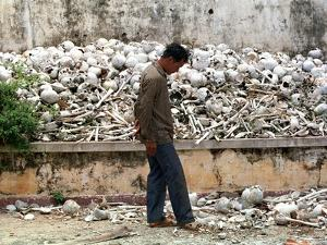 A Cambodian Man Walks Past One of the Many Killing Fields Sites