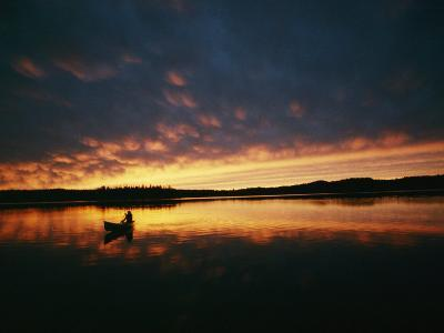 A Canoe at Sunset in East Manitoba-Bill Curtsinger-Photographic Print