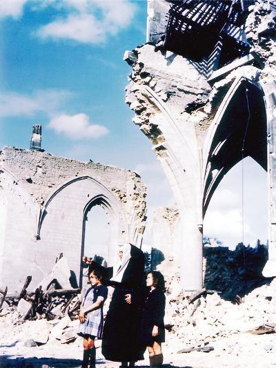 A Catholic Nun and Two Women with Children Standing in Front of the Ruins of Eglise Saint-Malo--Photographic Print