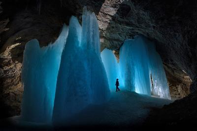 A Caver Is Dwarfed by the Scale of the Ice Formations in Eiskogelhoehle in the Austrian Alps-Robbie Shone-Photographic Print